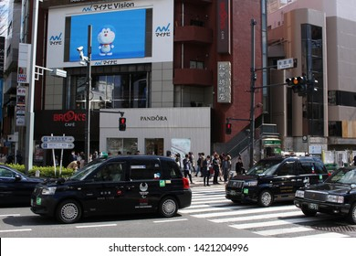 TOKYO, JAPAN - March 14, 2019: Toyota JPN Taxis with Tokyo Olympic 2020 logos in Tokyo's Omotesando area.