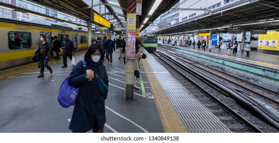 TOKYO, JAPAN - MARCH 15TH, 2019. Commuters at Shinjuku Railway Station in the morning.