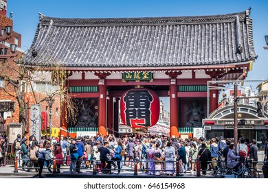 TOKYO, JAPAN - MARCH 17, 2016: Kaminarimon gate in front of Sensoji temple which is full of tourists at Asakusa.