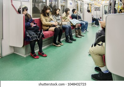 TOKYO, JAPAN  - MARCH 18, 2012: Passengers inside JR  subway line
