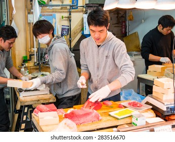 TOKYO, JAPAN - MARCH 20: Tsukiji Outer Market on March 20, 2015 in Tokyo, Japan. Tsukiji Market is the biggest wholesale fish market in the world.