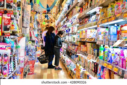 TOKYO, JAPAN - MARCH 2016: Customers in a Japanese supermarket