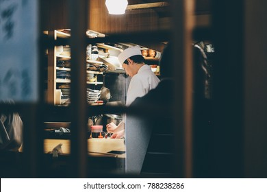 Tokyo, Japan - March 2017: Tokyo Sushi Bar Chef Street Photography Restaurant, Tokyo, Japan