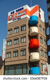TOKYO, JAPAN - MARCH, 2018: Building with balconies in the shape of a cup of coffee in the heart of Asakusa's 'Kitchen Town' or Kappabashi, Japan's restaurant supply store mecca.