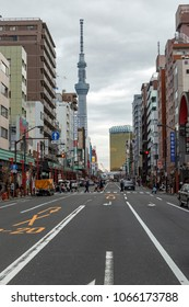 TOKYO, JAPAN - MARCH, 2018: The iconic Tokyo Skytree Tower overlooking the busy streets and crowded cityscape of downtown Tokyo, Japan's vibrant capital city.