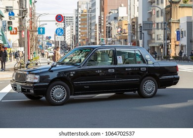 TOKYO, JAPAN - MARCH, 2018: One of the classic taxi car on Asakusa street in Tokyo.