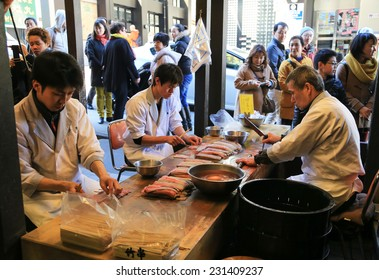 Tokyo, Japan - March, 21 2014 :  Japanese preparing fresh eel for cooking at the restaurant  in Tokyo