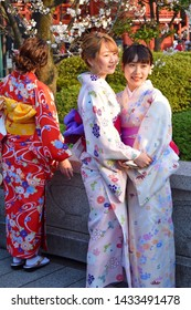 Tokyo, Japan - March 26th 2019; Japanese girls dressed like geishas are taking photo for social media by Sensó-ji temple