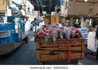 TOKYO, JAPAN - MARCH 27, 2015 : Vendor and tourist at the morning in Tsukiji Fish Market in Tokyo.
