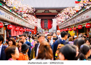 TOKYO JAPAN - MARCH 27, 2018 : Nakamise shopping street at Sensoji temple, Tourists walk shopping sweets & souvenirs before going to pay homage to statue in temple. Tokyo's must-see places to visit.