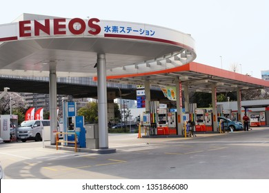 TOKYO, JAPAN - March 27, 2019: The forecourt of an Eneos gas station in Tokyo's Koto Ward. The blue pump in the foreground dispenses hydrogen.