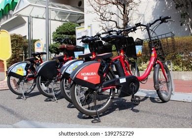 TOKYO, JAPAN - March 27, 2019: Electric bikes belonging to Toyko's public bicycle sharing scheme parked outside a golf practice range in Tokyo's Koto Ward.