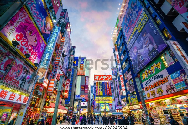 Tokyo, Japan - MARCH 28, 2017: Neon signs and billboard advertisements in  Akihabara electronics hub at twilight on March 28, 2017