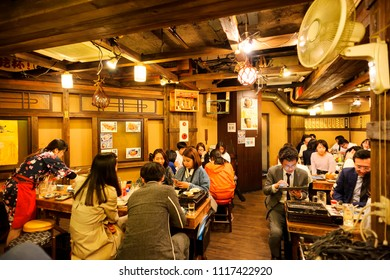 TOKYO JAPAN - MARCH 29, 2018 : Shinjuku neighborhood, After work Japanese people gather to eat and drink fun. interior of the restaurant is simply decorated in a unique contemporary Japanese style.