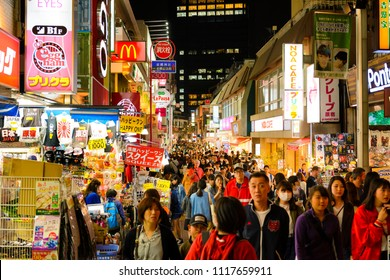 TOKYO JAPAN - MARCH 29, 2018 : Takeshita street at Harajuku neighborhood,  Unidentified tourists walk past this area has many shops full to shopping and fashion. Tokyo's must-see places to visit.