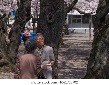TOKYO, JAPAN -MARCH 29TH, 2018. Old Japanese couple at the Yasukuni Shinto Shrine.