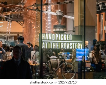 TOKYO, JAPAN - MARCH 2ND 2019. Interior view of Starbucks Reserve Roastery building signage at night. The newly opened establishment is the 5th of such outlet and is the largest in the world.