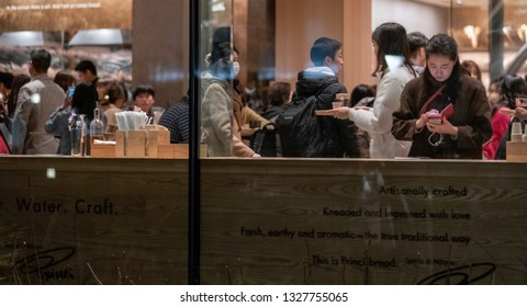 TOKYO, JAPAN - MARCH 2ND, 2019.  Customers at the Starbucks Reserve Roastery at night. The newly opened establishment is the 5th of such outlet and is the largest in the world.