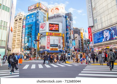 Tokyo, Japan, March 3, 2016: City street with crowd people on zebra crosswalk in Shinjuku town. Shinjuku is a special ward located in Tokyo for shopping