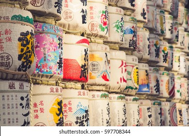 TOKYO, JAPAN - MARCH 30, 2016: A collection of Japanese sake barrels stacked is at the Japanese Meiji Shrine.