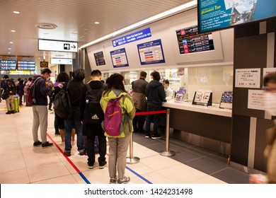 TOKYO, JAPAN - MARCH 31 : Japanese people and foreign travelers passenger wait and stand in queue for buy tickets MRT trains from auto vending machine at Ueno Station on March 31, 2019 in Tokyo, Japan