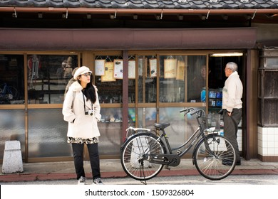 TOKYO, JAPAN - MARCH 31 : Traveler thai women and Japanese people walk shopping and travel visit in street market of Naritasan Omote Sando or Narita old town at Chiba on March 31, 2019 in Tokyo, Japan