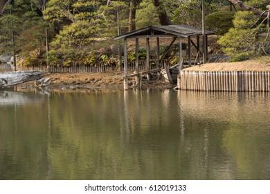 TOKYO, JAPAN – MARCH 5, 2017: A small Boatyard, Rikugien Garden, Bunkyo, Tokyo, Japan