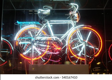 Tokyo, Japan - March 5: Sign of bicycle parking lot at Faret Tachikawa, Tokyo, Japan on March 5, 2016. The work 'Bicycloid IV' was created by Robert Rauschenberg in 1994.