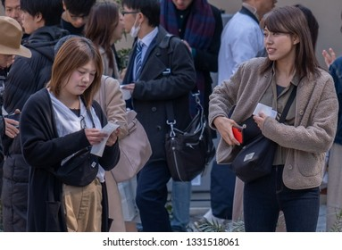 TOKYO, JAPAN - MARCH 5TH, 2019. People in the street of Nakameguro by the newly opened Starbucks Reserve Roastery building.