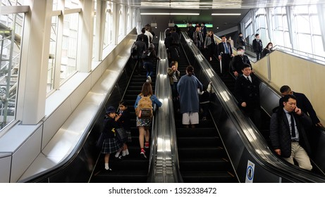 Tokyo, Japan - March 6, 2019 : people standing on elevator to go to platform of train station.