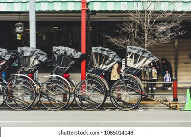 Tokyo, Japan -  March 7, 2018 : row of Japanese rickshaws parking at the sidewalk on Asakusa road, the rickshaw is popular among the tourists visiting Japan for sightseeing around travel attraction