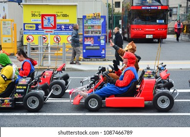 Tokyo, Japan - March 7, 2018 : Street kart tour, Mario kart tour is tourists dress up in superhero character costume and driving go-kart through the main travel attractions in the city of Tokyo