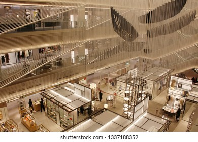 TOKYO, JAPAN - March 8, 2019: View of the interior of Tokyo's Ginza Six shopping complex including an installation, 'Six Ships', by Chiharu Shiota.