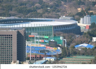 TOKYO, JAPAN - March 8, 2019: Overhead view of the under-construction National Stadium being built for the 2020 Olympics. The Meiji Jingu Stadium is in the foreground.