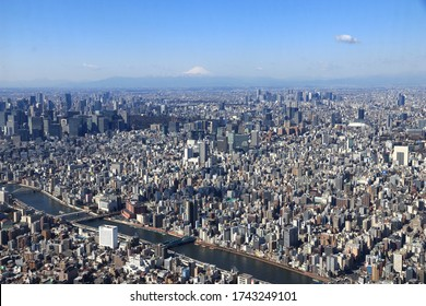 Tokyo  Japan - March, 8, 2019. Tokyo city overview and Mount Fuji with snow cap in a clear beautiful sunny day. Photoed from Skytree. Can see the skyscrapers in Shinjuku and Sumidakawa River.