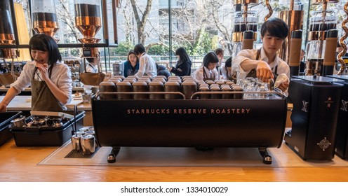 TOKYO, JAPAN - MARCH 9TH, 2019. Starbucks Reserve Roastery employee working behind the counter. The newly opened establishment is the 5th of such outlet and is the largest in the world.