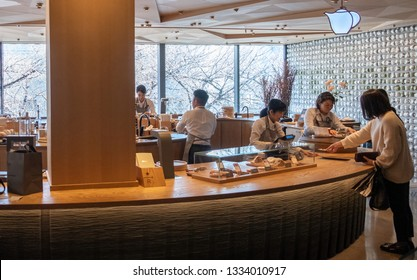 TOKYO, JAPAN - MARCH 9TH, 2019. Starbucks Reserve Roastery employee working at Teavana section. The newly opened establishment is the 5th of such outlet and is the largest in the world.
