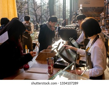 TOKYO, JAPAN - MARCH 9TH, 2019. Customers and barista at the Starbucks Reserve Roastery. The newly opened establishment is the 5th and the largest of its kind in the world.