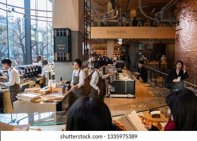 TOKYO, JAPAN - MARCH 9TH, 2019. Customers at the busy Starbucks Reserve Roastery coffee house. Wide angle view.