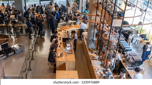 TOKYO, JAPAN - MARCH 9TH, 2019. Customers at the busy Starbucks Reserve Roastery coffee house. Top view.
