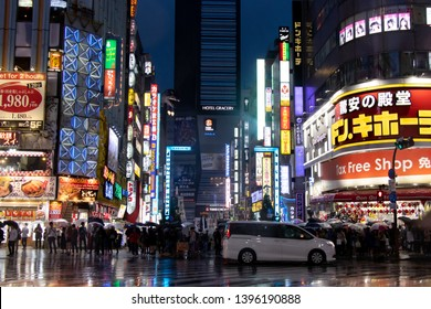 Tokyo, Japan - May 1, 2019 : Crowd wait to cross the road at street in front of Kabukicho district in Tokyo Japan.