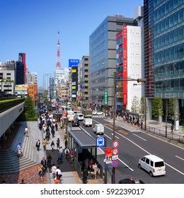 TOKYO, JAPAN - MAY 10, 2012: Commuters hurry in Minato district, Tokyo. Tokyo is the capital city of Japan and the most populous metropolitan area in the world with almost 36 million people.