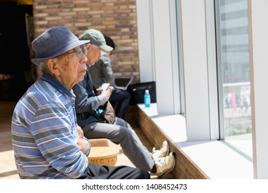 Tokyo, Japan - May 10, 2019 : Old man sitting in Atr'e vie looking outside with sad at JR Otsuka station in Tokyo, Japan.