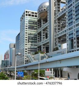 TOKYO, JAPAN - MAY 11, 2012: Fuji TV building in Tokyo. Fuji TV Studios building at Odaiba island was designed by famous Kenzo Tange and is one of most recognized buildings in Japan.
