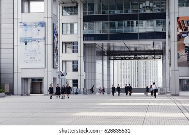 TOKYO, JAPAN - MAY 11, 2012: People visit Fuji TV building in Tokyo. Fuji TV Studios building at Odaiba island was designed by famous Kenzo Tange and is one of most recognized buildings in Japan.