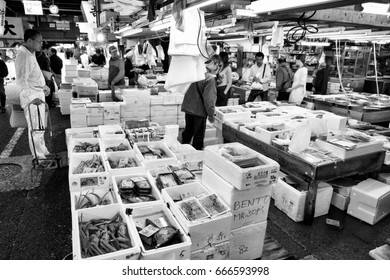 TOKYO, JAPAN - MAY 11, 2012: Shoppers visit Tsukiji Fish Market on May 11, 2012 in Tokyo. It is the biggest wholesale fish and seafood market in the world.