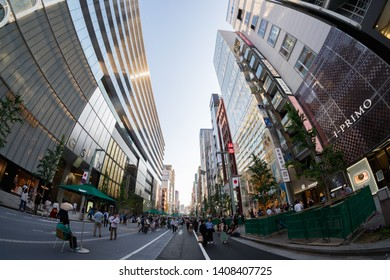 TOKYO, JAPAN - MAY 11, 2019 : People spending their time visiting Ginza street, a very popular shopping area of Tokyo, during weekend, Fisheye shot.