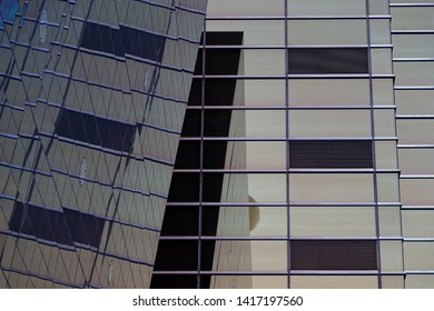 TOKYO, JAPAN, May 11, 2019 : Archiectural detail of a big wall of glass of the Asahi Beer Hall in Tokyo.