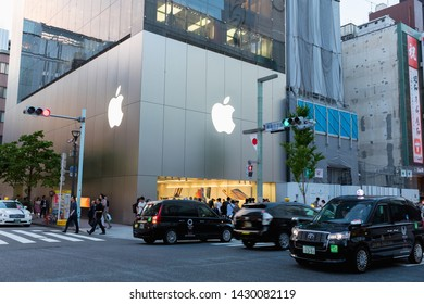 Tokyo, Japan - May 11, 2019: Exterior of an Apple store with pedestrians in the Ginza district of Tokyo, Japan. Apple is a multinational computer company.
