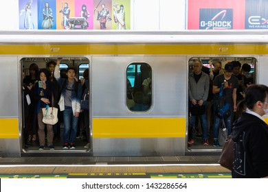 Tokyo, Japan - May 11, 2019. Passengers standing on train at JR station Otsuka in Tokyo, Japan. Rail transport in Japan is a major means of passenger transport.